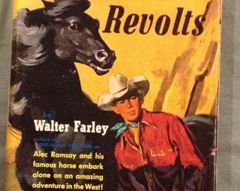 The Black Stalllion Revolts by Walter Farley in Dust Jacket