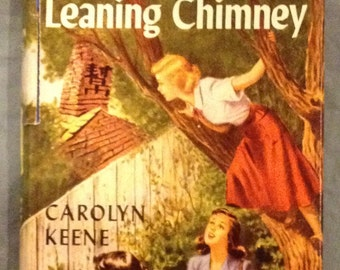 Nancy Drew - The Clue of the Leaning Chimney by Carolyn Keene. Wraparound dust jacket and blue silhouette endpapers.