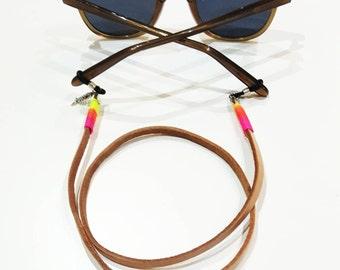 Cord hangs glasses California