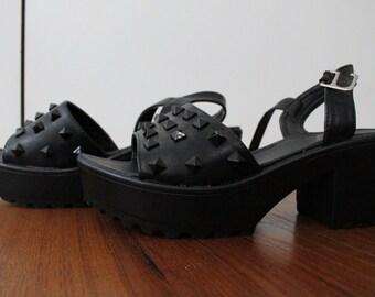 Black platform shoes with studs