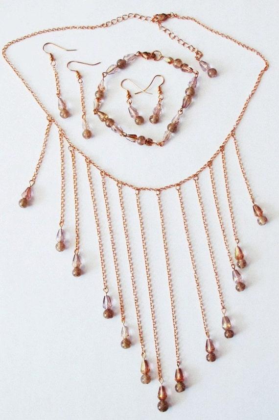 Elegant,  glow-in-the-dark pale pinkish-purple glass bead necklace, bracelet, duel earring set.