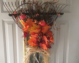 Fall leaves on rake wreath Active