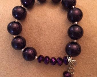 1 dark purple stretchable beaded bracelet w/charms