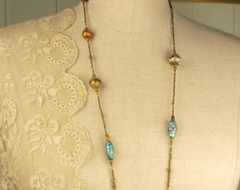 Vintage wedding cake and foil glass bead necklace.