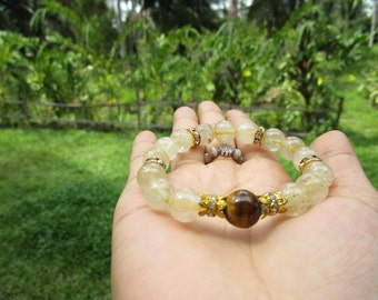 Bracelet made from Rutilated Quartz with Tiger eye stone and elastic.