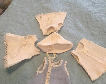 Four dresses or tops & cap for Goodreau vinyl ABC dolls or similarly sized dolls.