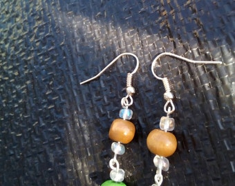 Homemade drop earrings ,brown and green wooden beads featuring glass seed beads