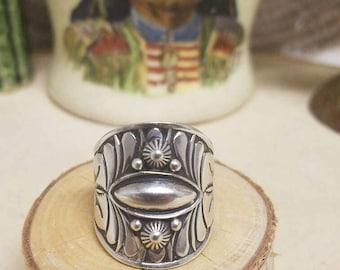 Derrick Gordon repousse sterling silver ring