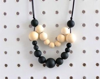 Auden symmetrical teething necklace, black silicone BPA free beads, untreated wood. Sensory,fiddling, breastfeeding, babywearing. FREE P+P*