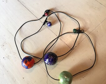 Ceramic necklaces sculpted and decorated by hand. Handmade ceramic necklaces. One of a kind!