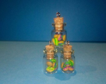 glass bottles with cakes in fimo