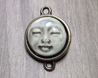 Framed Face Link Pendant in Pale Flesh and Brass Finish Pewter