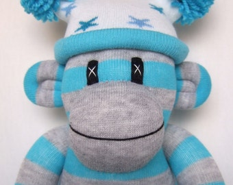 Cheeky grey and turquoise striped Sock Monkey with star design pom pom hat. Made to order