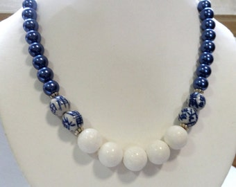 Blue mother of pearl, white oriental bead necklace