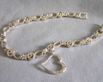 Vintage Avon heart bracelet.  Rhinestone charm bracelet. Avon signed