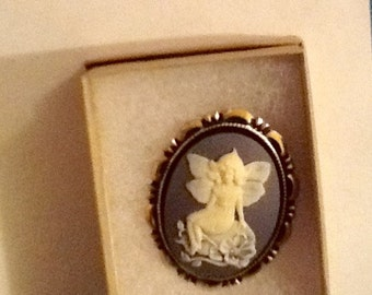 SEATED Cream colored Flower FAIRY CAMEO set in Goldtone Country Blue colored background with Rhinestone