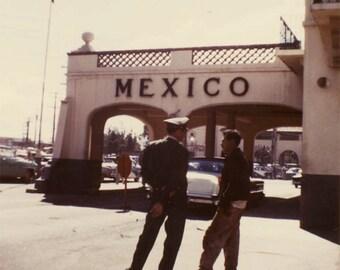 vintage photo 1970s Mexico Border Patrol Talks w Gringo by Cadillac Color Snapshot