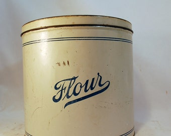 vintage metal flour canister container painted tin metal ivory with blue script writing vintage kitchen decor vintage home decor shabby chic