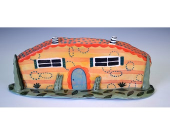 Southwestern style cottage with twin striped chimney's.