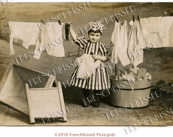 Victorian Toddler in Stripes Hanging Laundry to Dry Antique Postcard Digital Printable