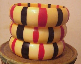 3 lucite striped bangle braclets, red, black and yellow 1970s