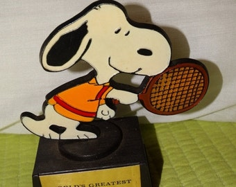 """Sale 1970's Peanuts, Snoopy playing tennis figure, Charles Schulz Creation, """"Worlds Greatest Tennis Player"""" Snoopy!, Hand Painted in Hong Ko"""