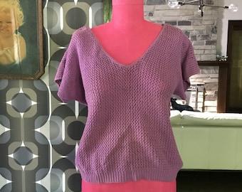 Vintage Diane Von Furstenberg short sleaved sweater top in purple.