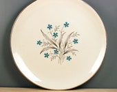 1950s dinner plate with blue flowers, mid-century modern serving.