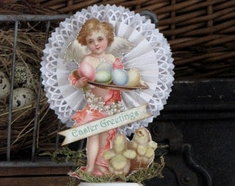 Vintage Victorian Inspired Easter Cherub Holding a Tray of Painted Eggs Standing on a Spool Rosette
