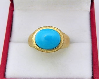 AAAAA Sleeping Beauty Turquoise Cabochon Top Color  from Arizona  11x9mm  2.70 Cts   in Ladies 18K Yellow gold cocktail ring 10 grams. 2635