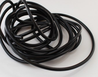 Rubber cord 4mm BLACK  , hollow tubing,by the yarrd