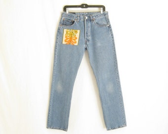 Vintage LEVIS 501 Straight Leg Made in U.S.A.  Patched Jeans. Size 32 x  32