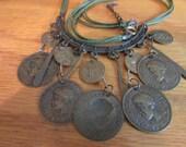 green cord coin necklace