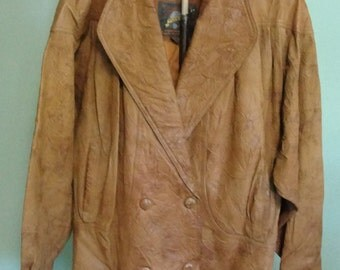 1980's Adventure Bound short leather jacket Women's size L with zip out lining Brown distressed leather