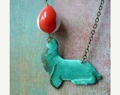 Sea Lion Pendant Circus Act Necklace   Turquoise Patina Brass with Vintage Lucite Orange White Balancing Ball