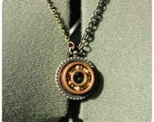 Roller Derby Bearing Necklace - pendant with copper and gold bearing