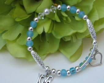 Memory Wire Bracelet with Ocean Blue Round beads and Charms