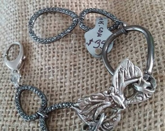 fine silver magical mask with vintage links to adorn your wrist