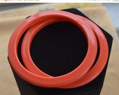 On sale Pretty Vintage Coral Orange Plastic Bangle Bracelets (2)