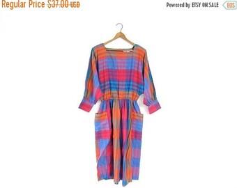 Vintage 80s colorful rainbow dress. striped batwing wiggle dress. pocket dress. midi dress. long sleeved dress.