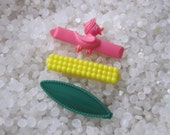 vintage  barrette plastic childs barrettes, bright yellow bubbles dark green oval, pink ducky