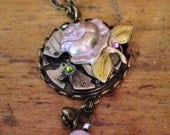 HandPainted Light Pink Rose Glows atop Movement Steampunk Necklace