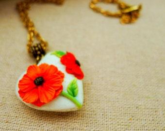 Orange, green, mint, black and gold floral heart-shaped pendant locket