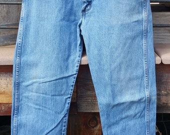 Wrangler Denim Blue Jeans Size 34 x 34 Distressed And Worn