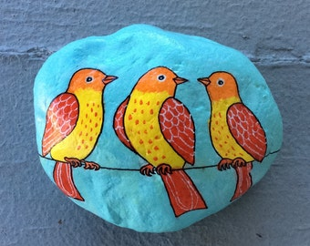 Three yellow birds on a wire painted rock paperweight