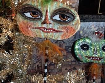Paper Mache ornament Pumpkin head on a stick with big brown eyes SALE!