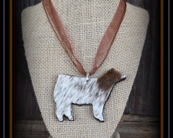 "Shorthorn Hair On Hide show steer 3"" wide leather pendant with cord"