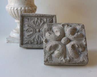 two cement architectural brick details