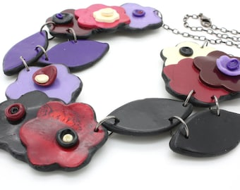 Purple, red, and black flower and leaf handmade polymer clay necklace
