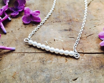 Tiny pearl necklace with silver chain